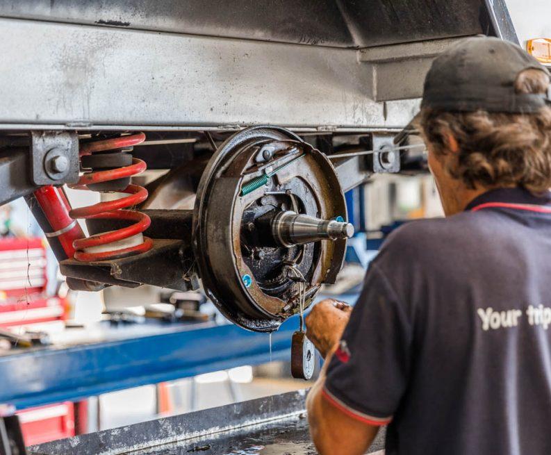 A worker making caravan repairs at the workshop in Coffs Harbour